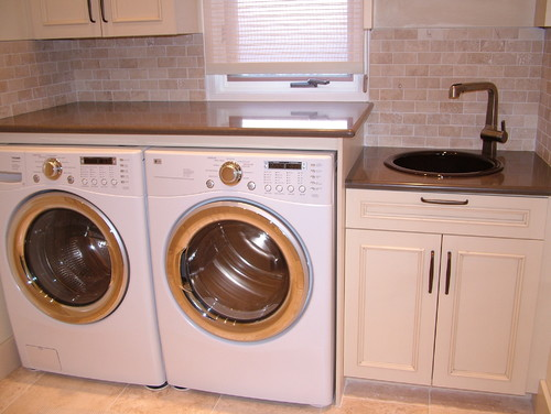 With the washer on outside wall,how was the plumbing done?Thanks