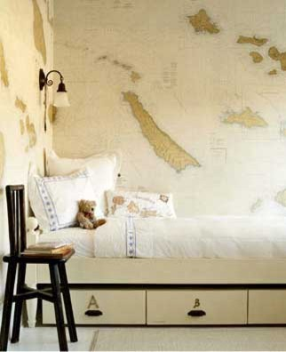 Fun neutral bedroom with map wallpaper