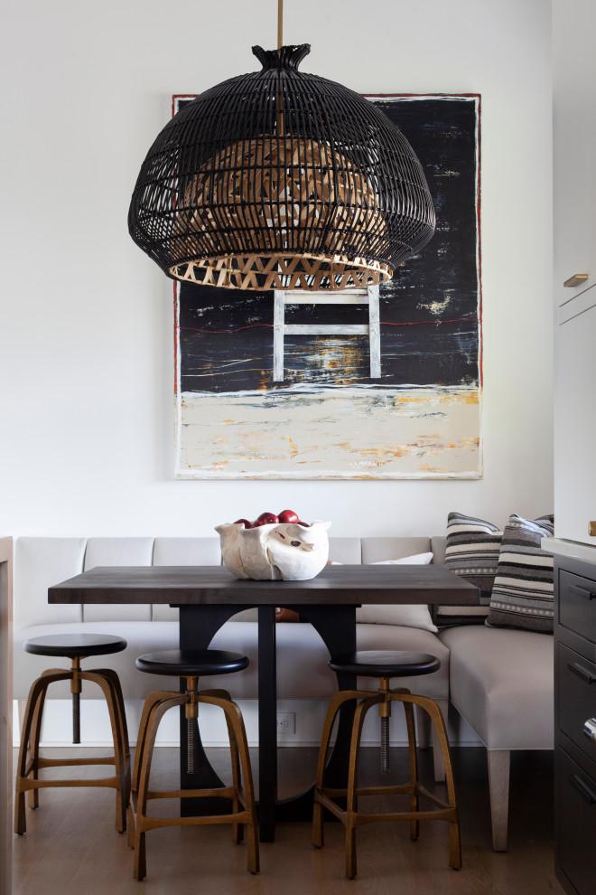 Trendy medium tone wood floor and brown floor breakfast nook photo in Charlotte with white walls