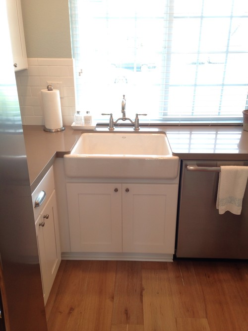 Check out this beautiful little Kohler farm sink with bridge faucet ...