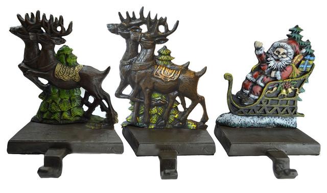 cast iron santa claus and reindeer stocking holder. Black Bedroom Furniture Sets. Home Design Ideas