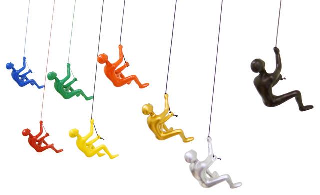 The Collection 8-Piece Climbing Man Wall Art Sculpture.