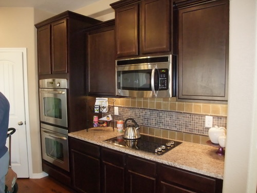 Should I paint my dark Kitchen cabinets??