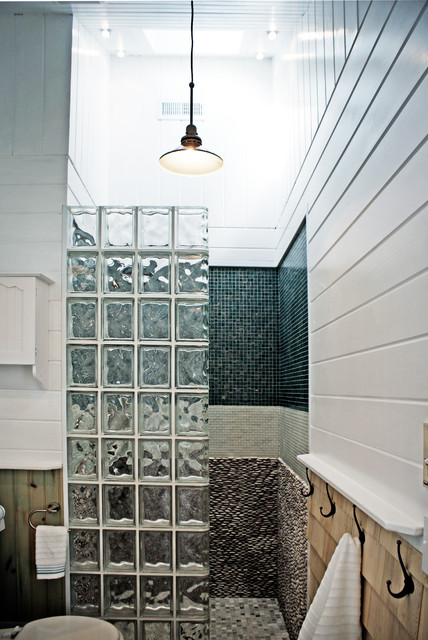 Doorless shower - beach style pebble tile doorless shower idea in DC Metro