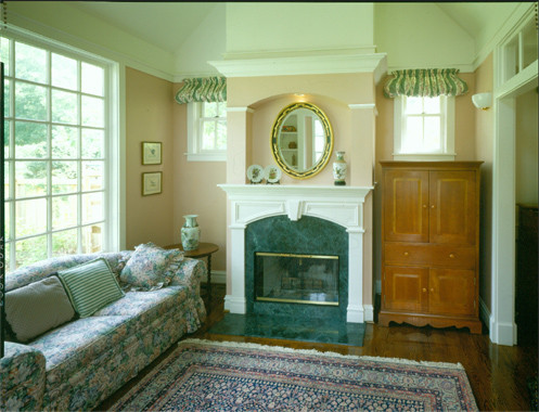 Example of a mid-sized classic enclosed dark wood floor family room design in Chicago with beige walls, a standard fireplace and a stone fireplace