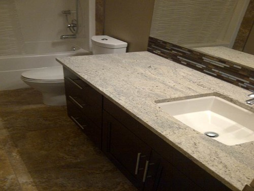 White bathroom vanities ideas - Tile To Go With Kashmir White Granite And Dark Cabinets