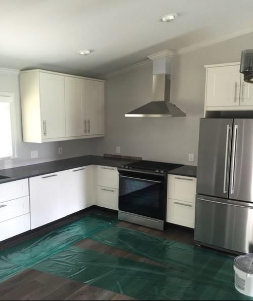 new modern kitchen with a rustic thin brick backsplash added