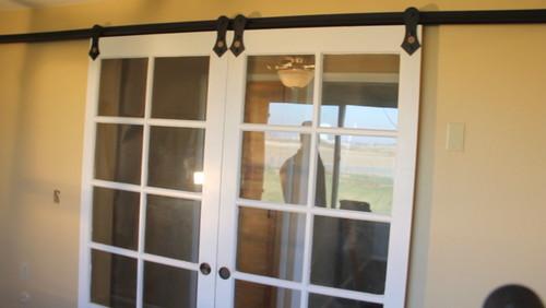 Converting french doors to sliding barn door hardware for Sliding doors that look like french doors