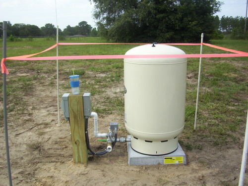 Trring to hide a outdoor 80 gallon well water pressure tank for Household water tank design