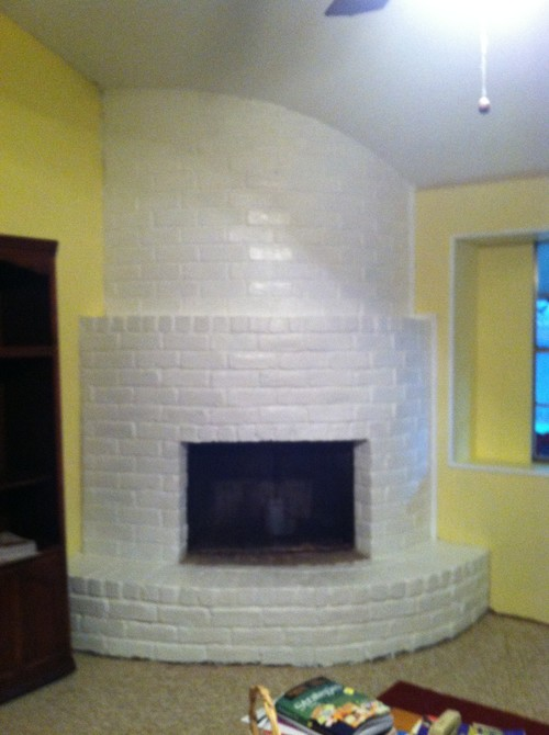 "I recently repainted my corner brick fireplace all white. It goes from floor to ceiling and is a ""monster"" in my book. I"