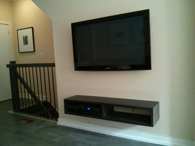 TV + Home Theatre Speaker Wall mount Installation with concealed cords  contemporary-living-room