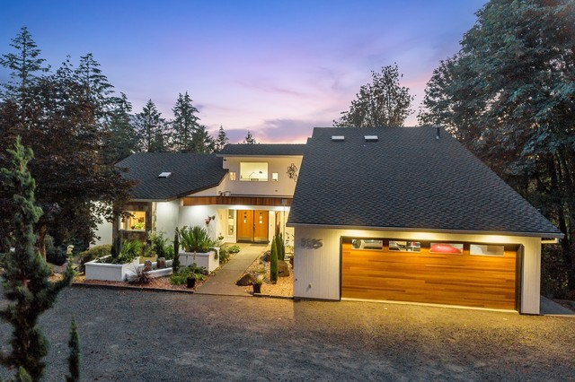 Example of a large minimalist white three-story wood house exterior design in Portland with a hip roof and a shingle roof