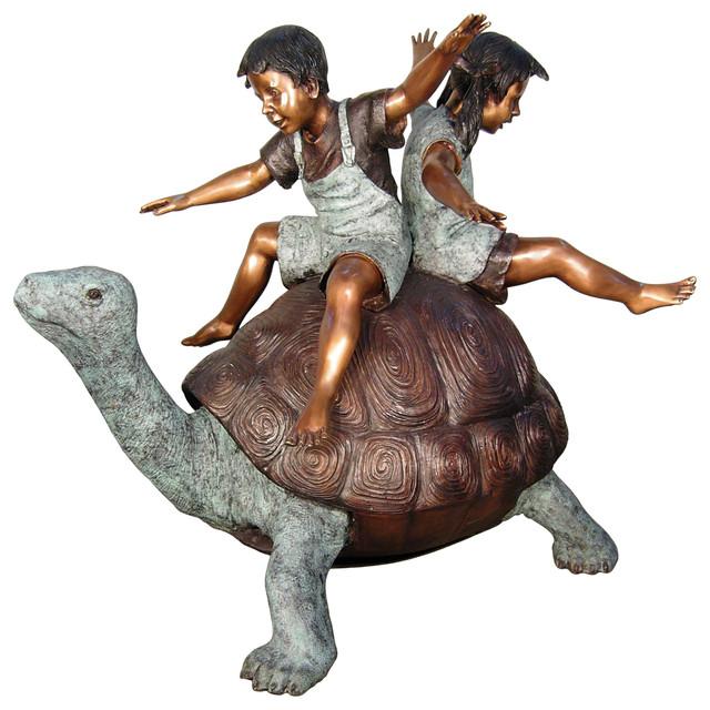 2 Kids Balancing On A Tortoise Beach Style Garden
