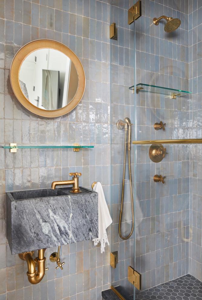 Bathroom - coastal blue tile bathroom idea in New York with blue walls, a wall-mount sink and a hinged shower door