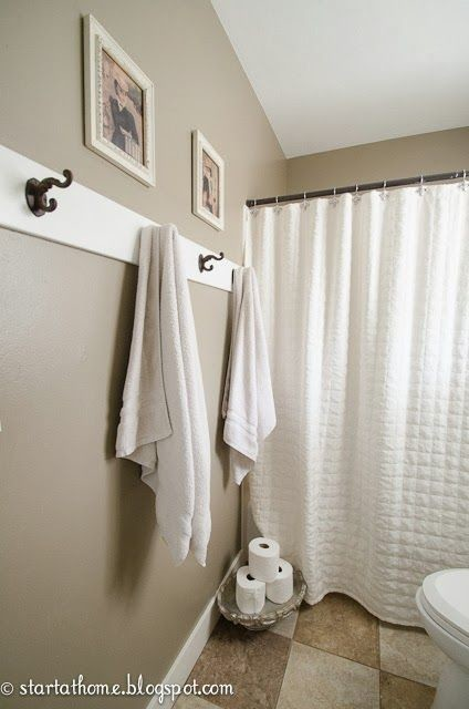 How to hang towels in bathroom for Bathroom pictures to hang on wall
