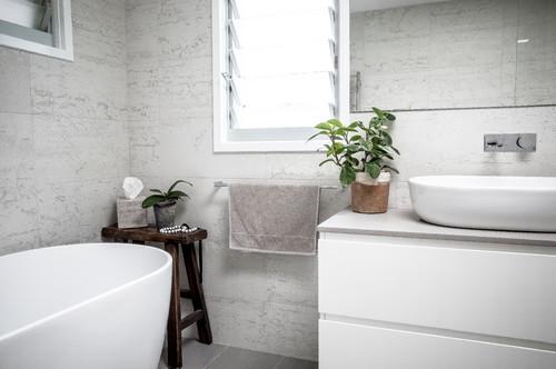 modern coastal bathroom corner styled with plant