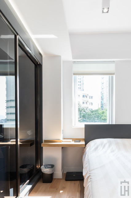 Example of a trendy home design design in Hong Kong