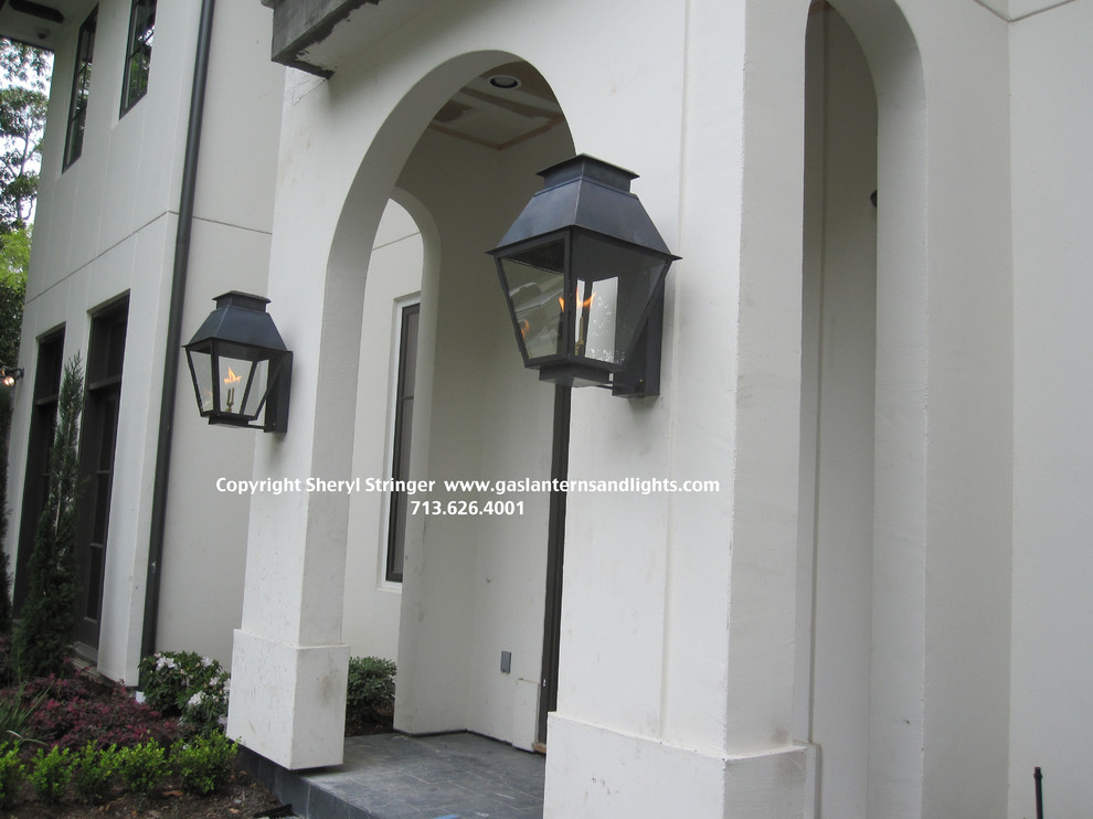 Sheryl's Extra Large V Style Gas Lanterns on Contemporary Home