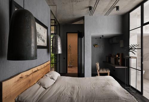 grey textured walls with grey bed in wabi sabi style bedroom.