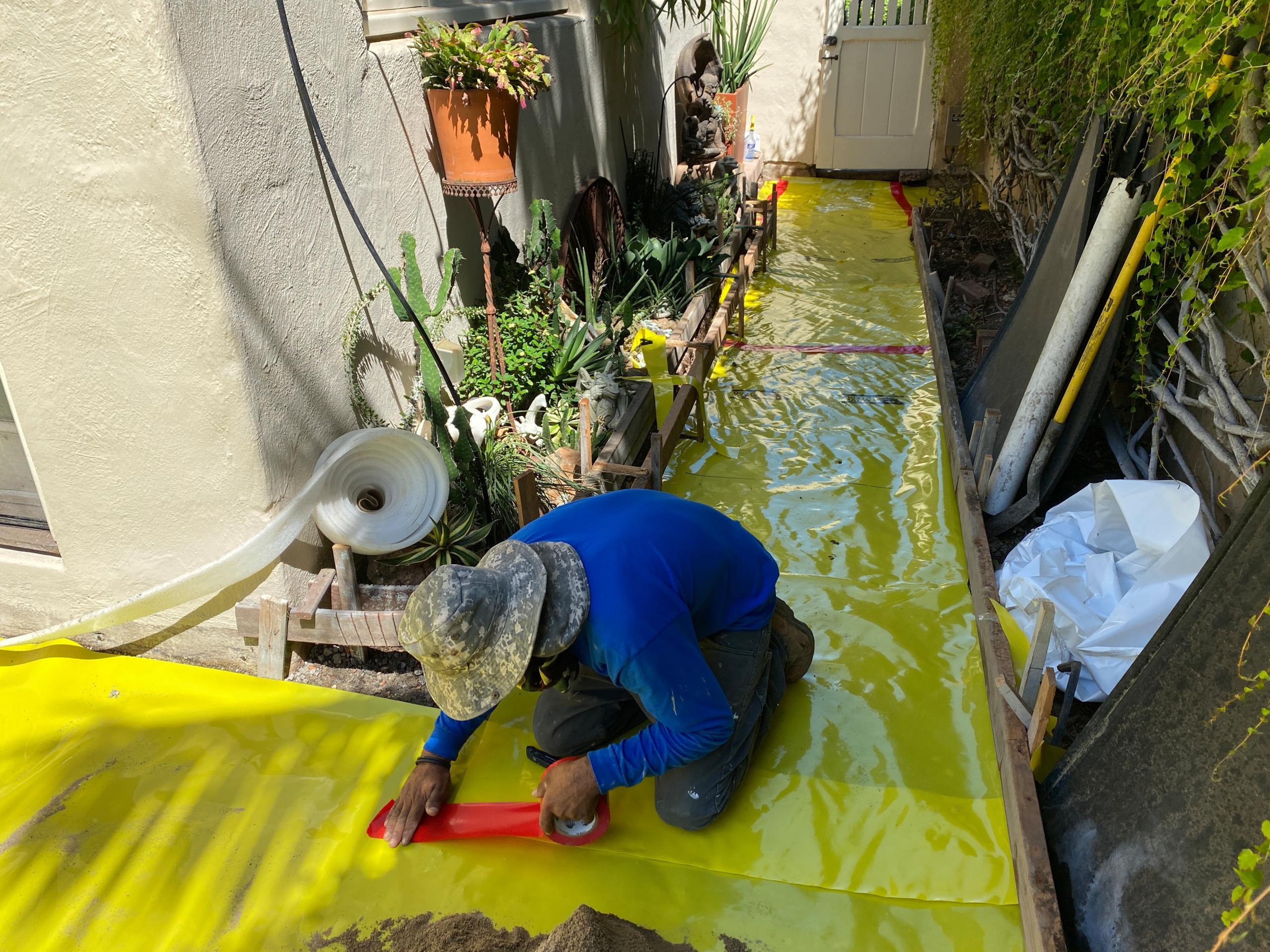 Installing Stego Wrap Waterproof Membrane