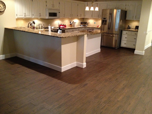 Porcelain plank wood look tile installations tampa florida for Hardwood floor tile kitchen