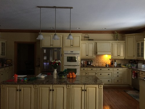 North facing kitchen with buttercream cabinets for Butter cream colored kitchen cabinets
