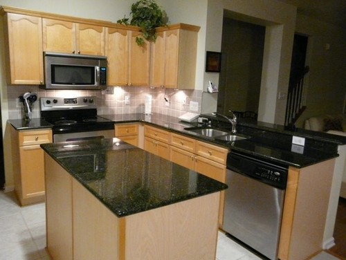 Here is a link that might be useful: Uba Tuba Granite Countertops in  Charlotte NC