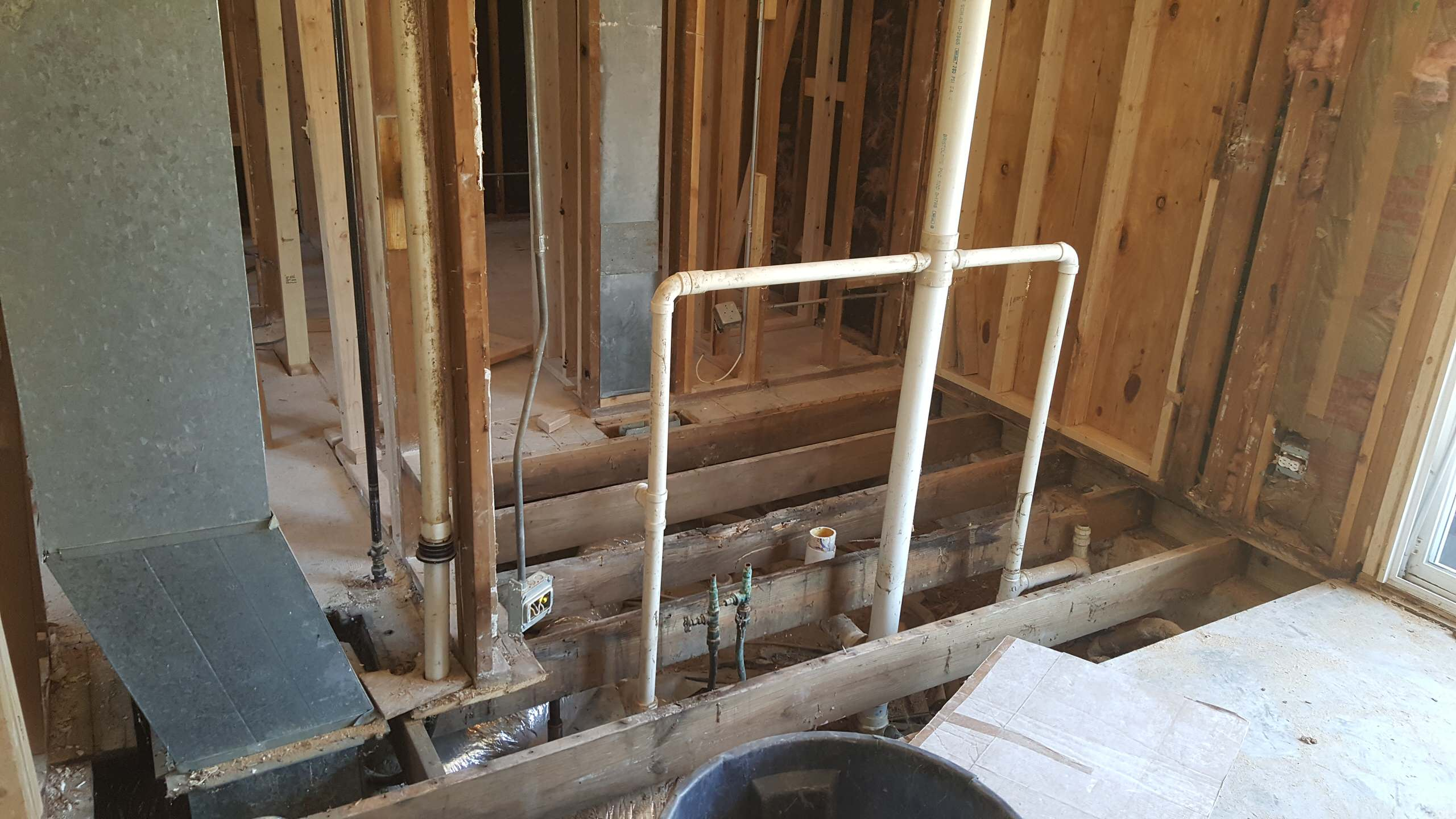 Bathroom Stripped to framing with new exterior shower wall