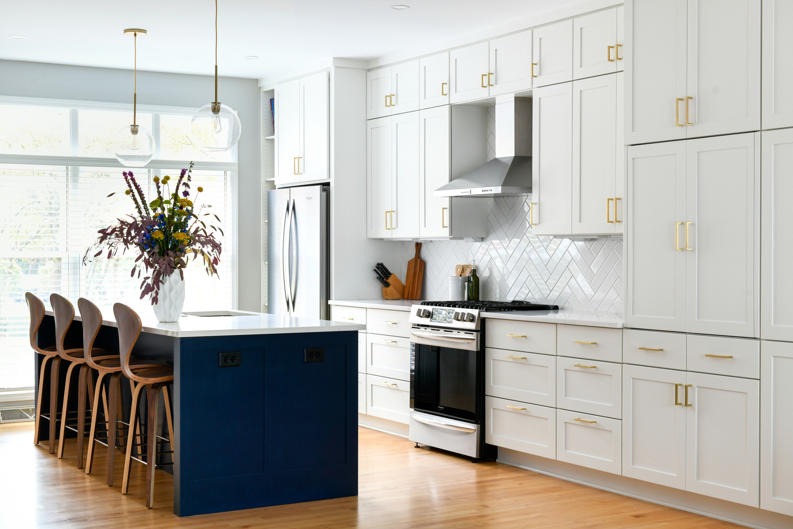 Blue, White and Gold Kitchen and Living Space