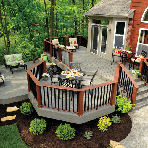 Each section of this deck has a distinct purpose and shape. The curved seating section on the top level is intimate and the perfect spot to sip morning coffee. One step down is the dining area, which over looks the yard, and still lower is a secondary, larger, seating area.