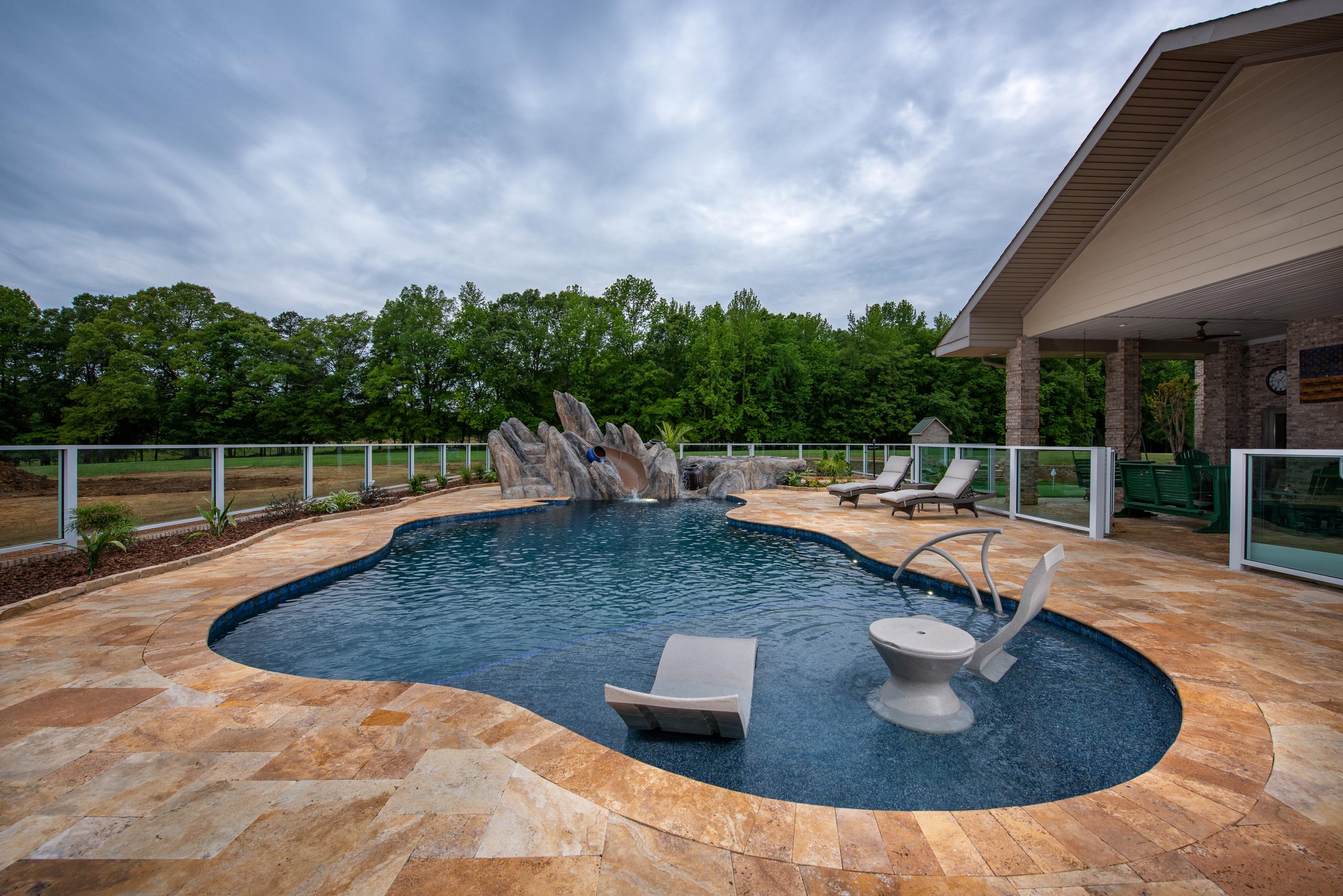Vineyard view pool with custom slide and boulder work