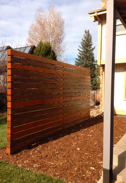 Cedar Slat Wall Creates A Privacy Screen For Modern Patio