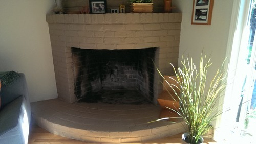Looking for a contemporary gas fireplace for curved mantle in living room corner. Home is California ranch style