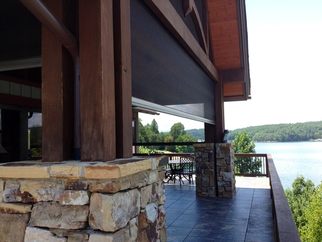 Motorized screens at lake house with folding wall for Motorized outdoor patio screens