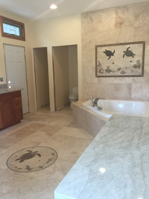 Help Tie In Taj Mahal Grey Counters With Ivory Travertine