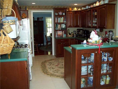 Pictures Show Blue Dining Room With Door To Kitchen On Left Entry And Third Picture Is View Of Front