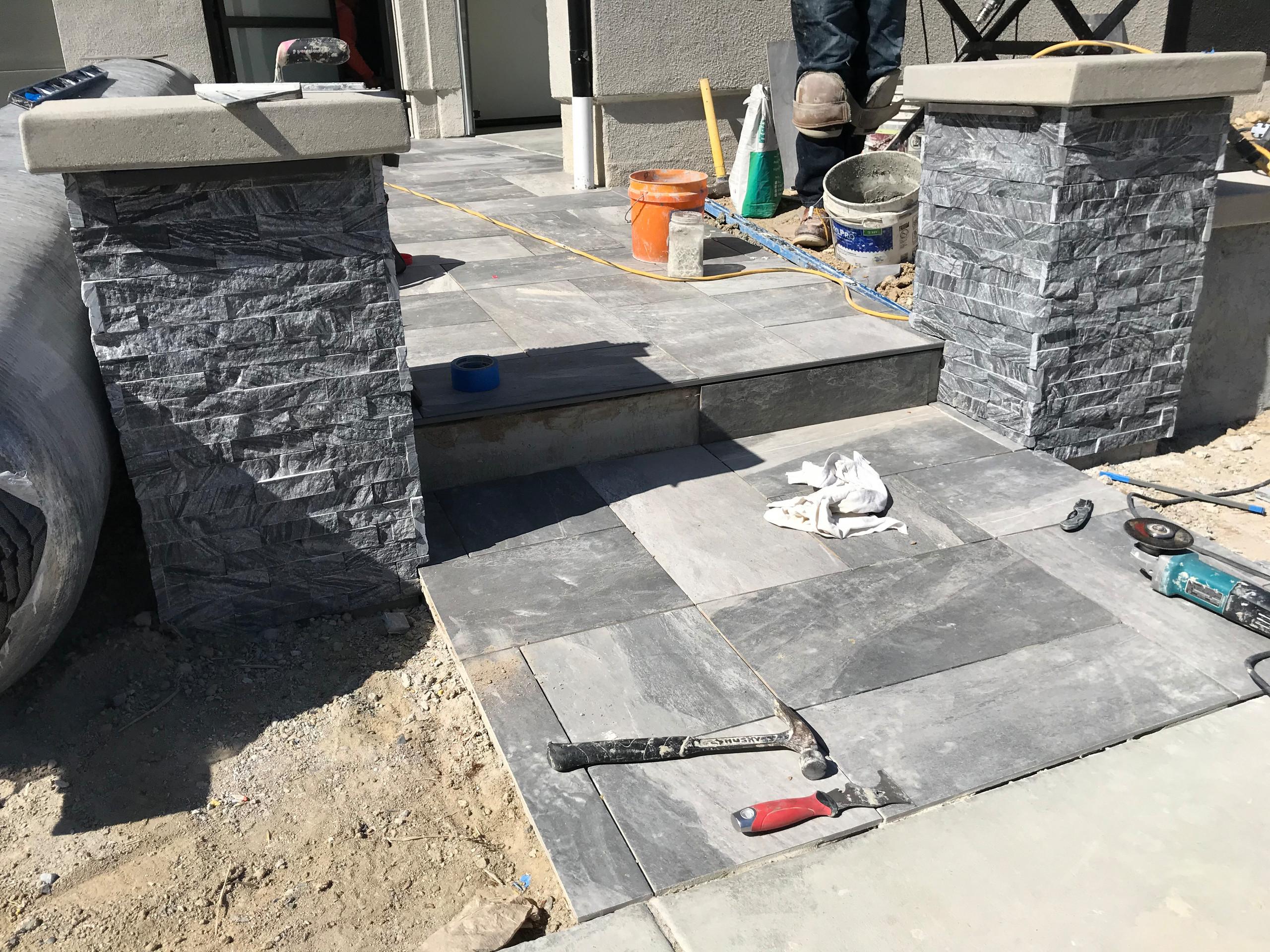 Stone Veneer and Porcelain Walkway