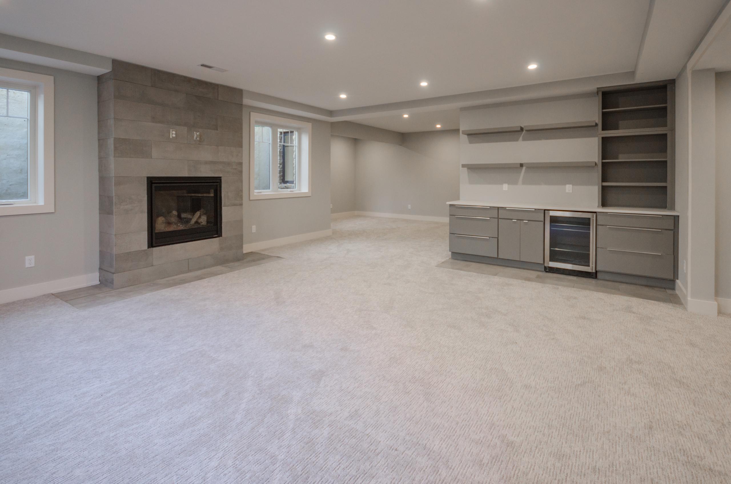 Lower Level Beverage Center & Fireplace