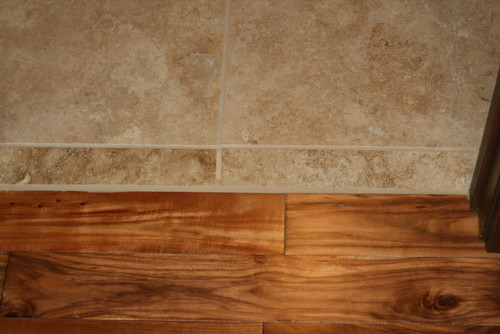 Tile To Wood Floor Transition the transition in our case the wood flooring is 34 thick so we need the tile to be installed at the same height we opted for schluter ditra xl which See Attached Top Picture With Floor Board As Transition The Bottom Picture With Tipping Tile Pieces As Transition We Hate To See Overlap Moldings All Over