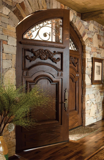 Custom mahogany arched double doors mediterranean for Main door arch designs