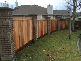 North Delta Curved Fence Between Brick Columns