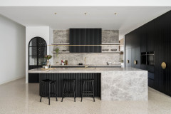 Kitchen Tour: Black Cabinetry and Pale Marble Create a Luxe Look