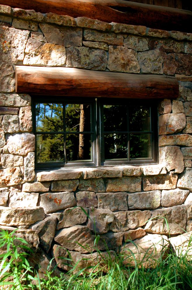 Example of a mountain style home design design in Denver