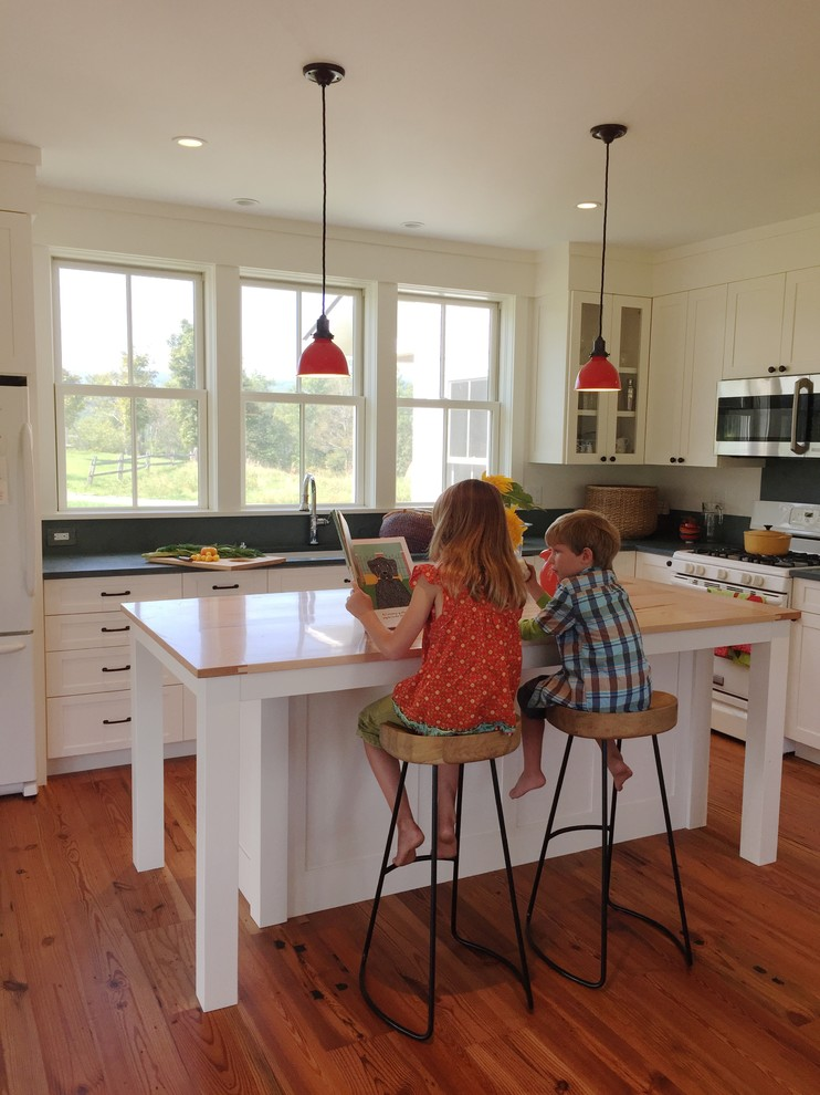 Large farmhouse home design photo in Burlington