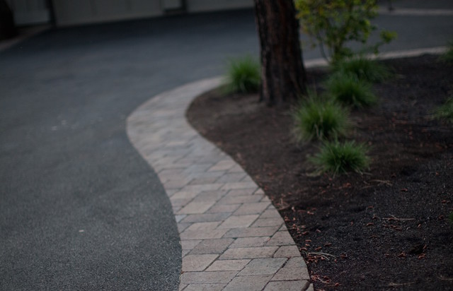 Inspiration for a contemporary brick landscaping in Other.