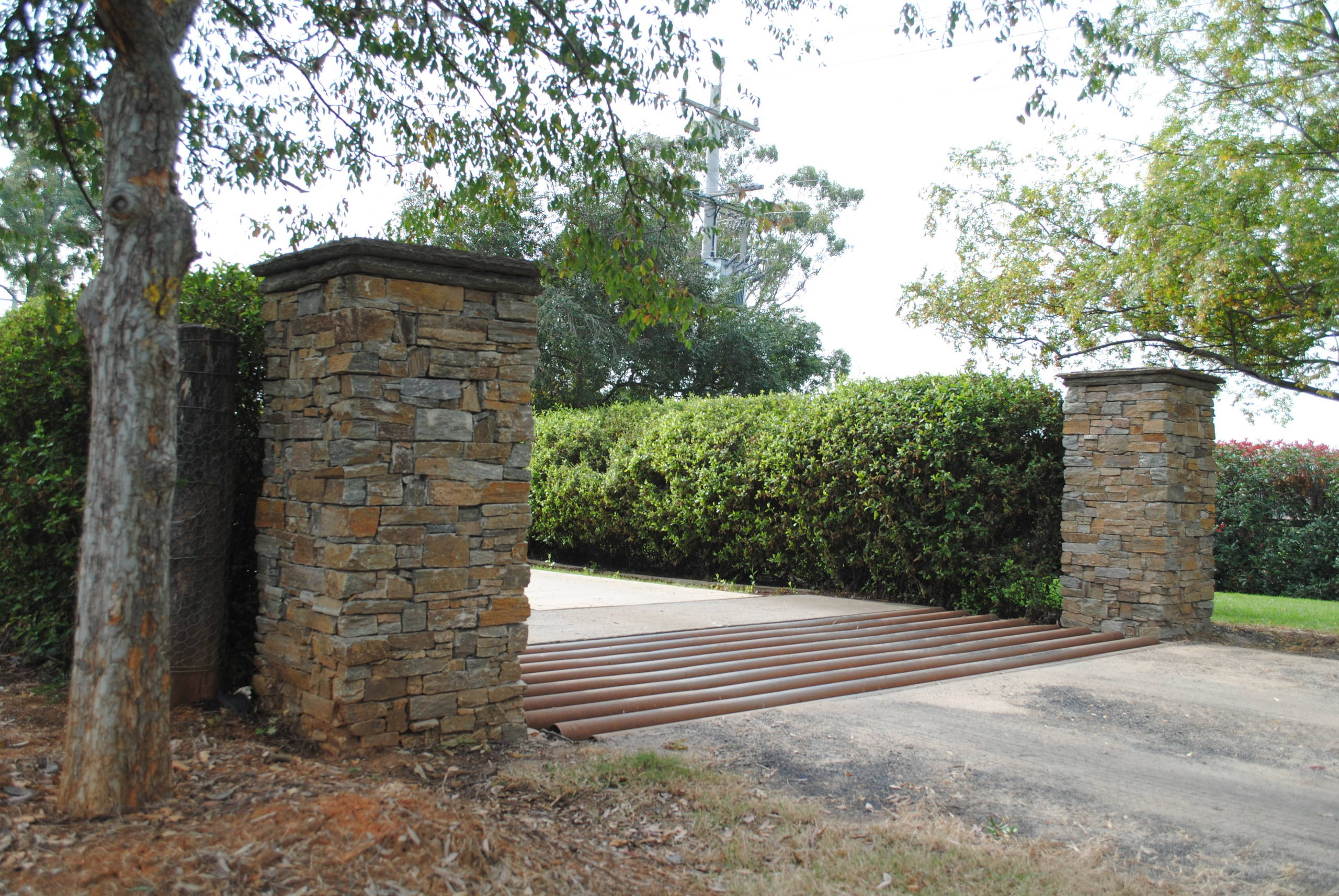 Expansive driveway with classic stone cladding