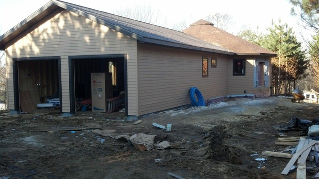 Mid-sized arts and crafts one-story concrete fiberboard exterior home photo in Other