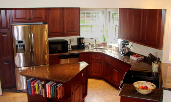 Kitchen renovation with island and angled peninsula for Kitchen cabinets 45 degree angle