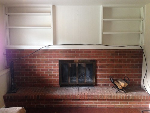 Help with redesigning a large brick fireplace! Paint or complete reno