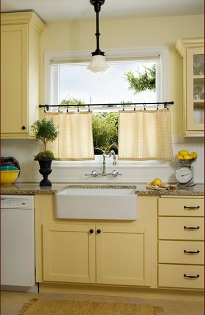 Elegant kitchen photo in Portland with yellow cabinets